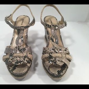 """Express woman's Faux Snake Skin Wedge s 8. 3 1/2"""""""